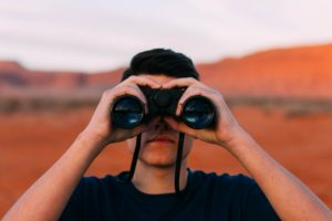 Man Spying with Binoculars